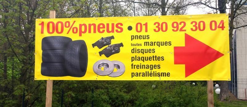 Bâches publicitaires pour 100% Pneus MultiGome à Mantes.