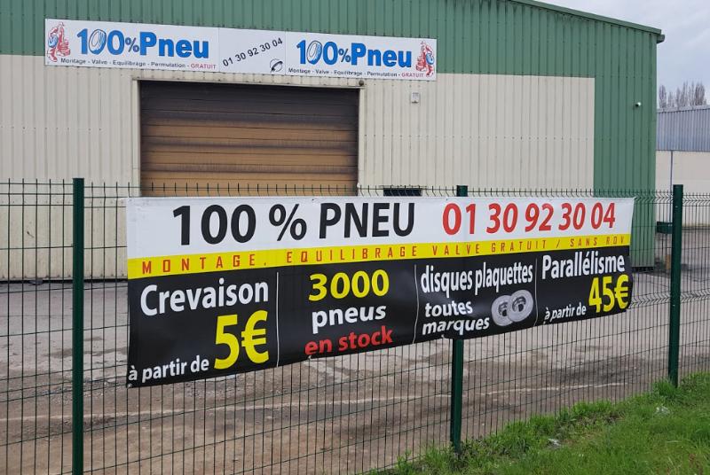 Réalisation du Studio - Bâche publicitaire pour 100% Pneus à Mantes-la-Ville